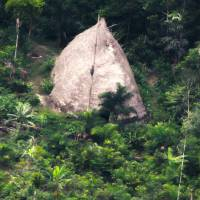 This 2017 photo released by the National Indian Foundation (FUNAI) shows a 'maloca,' or long house, in Vale do Javari, Amazonas state, Brazil. Overall, the agency has registered 107 isolated tribes in Latin America's largest nation. While isolated communities are sometimes captured on video, Funai does not make contact with them. | FUNAI / VIA AP