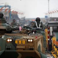 South Korean Marine Corps amphibious assault vehicles take part in the annual Foal Eagle exercises with the U.S. in Pohang on April 5. | REUTERS
