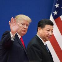 U.S. President Donald Trump and Chinese leader Xi Jinping leave a business leaders' event at the Great Hall of the People in Beijing last November. | AFP-JIJI