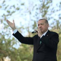 Turkish President Tayyip Erdogan addresses his supporters in Bayburt, Turkey, on Friday. | PRESIDENTIAL PALACE / VIA REUTERS