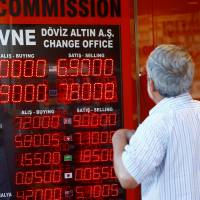 Turkish central bank tries to contain currency crisis