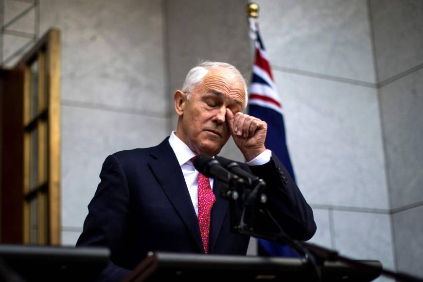 Australian Prime Minister Malcolm Turnbull, fighting for political life, dumps tax policy