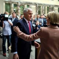 Australia's Prime Minister Malcolm Turnbull and Foreign Minister Julie Bishop leave after a news conference in Canberra on Tuesday. Turnbull narrowly survived a leadership challenge from within his own party on Tuesday as discontent with his rule boiled over less than a year before national elections. | AFP-JIJI