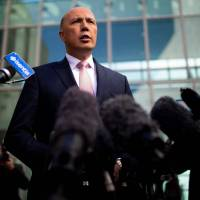 Australia's former home affairs minister, Peter Dutton, faces the media at a news conference in Canberra on Tuesday. | AFP-JIJI
