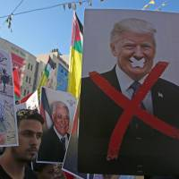 Trump cuts more than $200 million in U.S. aid to Palestinians
