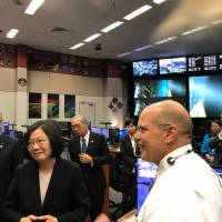 A NASA official guides Taiwanese President Tsai Ing-wen (second from left) and others during a visit to the U.S. space agency's Johnson Space Center on Sunday in this photo taken from the Taiwanese Foreign Ministry's official Twitter account.