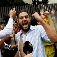 Opposition legislator Juan Requesens clashes with National Guardsmen during a protest outside the Supreme Court of Justice in Caracas on March 30.   REUTERS