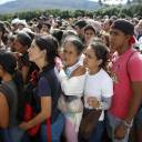 Venezuelans wait in line to cross into Colombia through the Simon Bolivar bridge in San Antonio del Tachira, Venezuela, July 17. The United Nations says an estimated 2.3 million Venezuelans had fled the country as of June, mainly to Colombia, Ecuador, Peru and Brazil.
