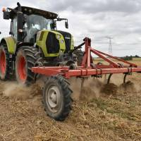A farmer drives a tractor in his field near Bouloire in north-western France on Aug. 21, after a harvest was weakened by a recent heat wave. The heat, which swept across much of northern Europe this summer, has caused reductions in wheat output in France — the EU's top producer of the crop — cutting estimates by some 2 million tons from last years figures. | AFP-JIJI