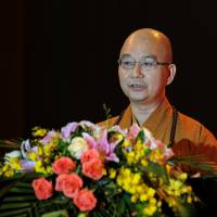 Shi Xuecheng, the abbot of the Longquan Temple and then deputy secretary of the Buddhist Association of China, speaks during a Buddhist culture festival in Shenzhen on Oct. 25, 2013. | REUTERS
