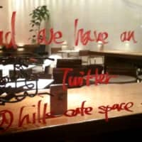 A cafe in Roppingi Hills urges passersby to follow its Twitter account: @hillscafespace