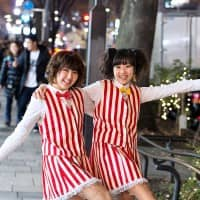 These two fans of boy-band Arashi got creative and made their own tattoo stockings with the band members' names. Photo courtesy of Tokyo Fashion