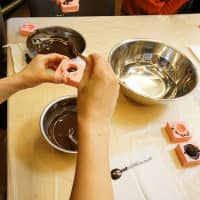 Filling the molds with chocolate. Photo courtesy of FabCafe