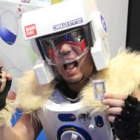 A man costumed in vending machine attire demonstrates new Bondai products.