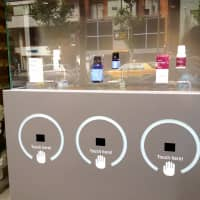 The Aroma Shower allows passersby to test three @aroma essential oils by waving their hands over sensors that trigger a huge diffuser.