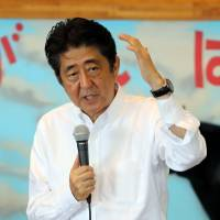 Prime Minister Shinzo Abe makes a speech in the town of Shintomi, Miyazaki Prefecture, on Sunday before officially announcing his candidacy for the Liberal Democratic Party's presidential election in September. | KYODO