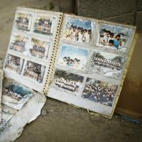 Volunteer group in Hiroshima cleans photos from areas hit by torrential rain to preserve precious memories
