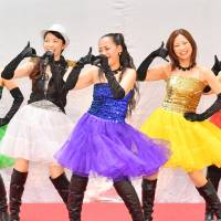 Members of Dream 39 — (from left) Shige, Hazuki, Riko, Nao and Akane — perform at San-A Hamby Town in Chatan, Okinawa Prefecture, on June 17.   THE OKINAWA TIMES
