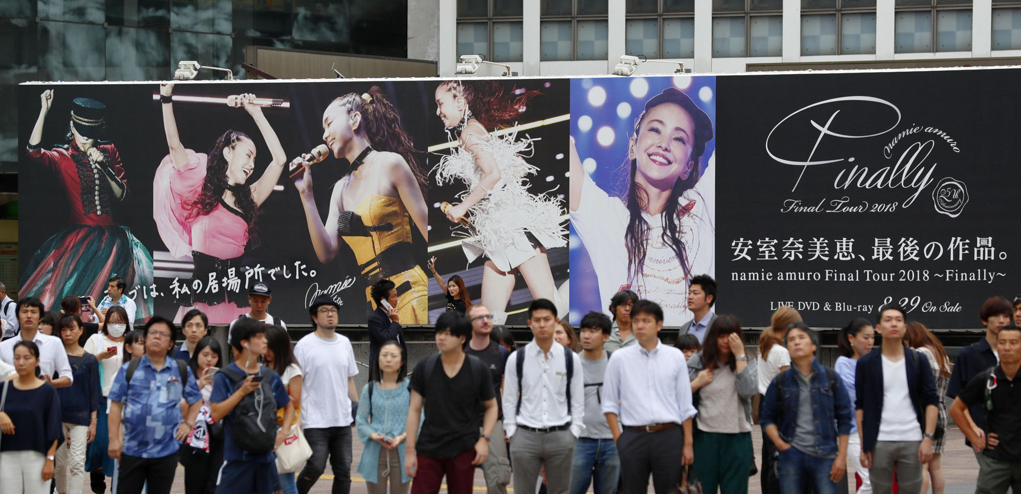 An advertisement near Shibuya Station promotes a video recording of Namie Amuro's last music tour, which hit stores Wednesday. | KYODO