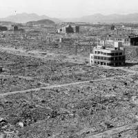 The three-story Kirin Beer Hall building remains standing in the city of Hiroshima, which was devastated by the August 1945 atomic bombing, in a photo taken in October 1945. | HIROSHIMA PEACE MEMORIAL MUSEUM / VIA KYODO
