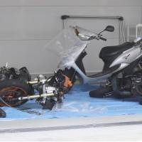 Two damaged motorcycles and a scooter involved in a fatal accident in the city of Nara on Friday are displayed to the media. | KYODO