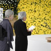 Emperor Akihito delivers a speech at Tokyo's Nippon Budokan Hall on Wednesday during an annual ceremony commemorating the end of World War II. Standing behind him is Empress Michiko. | KYODO