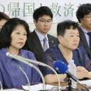 Eiko Kawasaki (front right) and others who defected from North Korea to Japan hold a news conference in Tokyo on Monday.