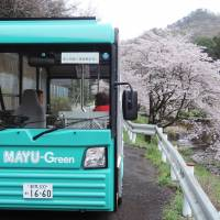 A low-speed electric bus makes its rounds in a mountainous area on the outskirts of Kiryu, Gunma Prefecture. | KYODO