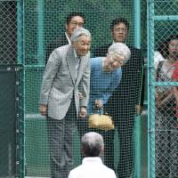 Emperor Akihito and Empress Michiko visit the tennis court where they met first 61 years ago in the resort town of Karuizawa, Nagano Prefecture, on Saturday.   KYODO