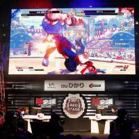 Esports contestants play during a competition in Chiba Prefecture on Feb. 10. Commercial stakeholders in the activity hope competitive multiplayer video gaming will become a medal event in future Olympics. | KYODO