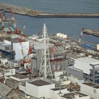 The defunct Fukushima No. 1 nuclear power plant, which was hit by a triple core meltdown in March 2011, is shown in February. | KYODO