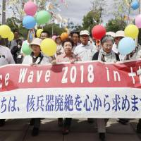 Atomic bomb survivors march in the city of Nagasaki in July, calling for the abolition of nuclear weapons. Given the advanced age of the survivors, Nagasaki Prefecture has been training people to become storytellers on behalf of them. | KYODO