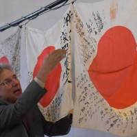 Obon Society works to heal World War II wounds by returning wartime flags, but labor of love has a cost