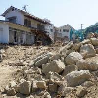 Devastated houses are shown Sunday in Kuchita, a part of Hiroshima's Asakita Ward that hosts a large population of foreign residents. | MAGDALENA OSUMI