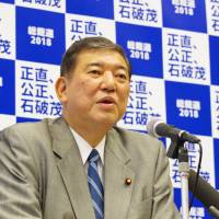 Former Defense Minister Shigeru Ishiba speaks at a news conference in Tokyo on Friday. Ishiba said the ruling Liberal Democratic Party should not rush on revising the Constitution. | REIJI YOSHIDA