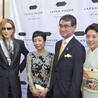 Foreign Minister Taro Kono attends the opening event for Japan House Los Angeles in Hollywood on Friday, along with Yoshiki of rock band X Japan (left) and others. | KYODO