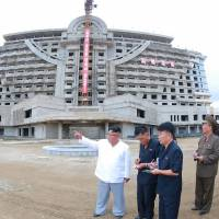 North Korean leader Kim Jong Un inspects the construction site for the Wonsan-Kalma coastal tourist area in Kangwon Province in this photo released on Friday. | AFP-JIJI