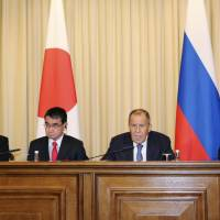 Facing reporters (from left) Japanese Defense Minister Itsunori Onodera, Japanese Foreign Minister Taro Kono, Russian Foreign Minister Sergey Lavrov and Russian Defense Minister Sergei Shoigu attend a news conference Tuesday in Moscow following two-plus-two talks. | KYODO
