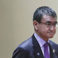 Foreign Minister Taro Kono arrives for the ASEAN-Japan Ministerial Meeting on the sidelines of the 51st ASEAN Foreign Ministers Meeting in Singapore on Thursday. | AP