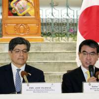 Foreign Minister Taro Kono (right) speaks during a joint news conference with his Ecuadorian counterpart, Jose Valencia, after their meeting in Quito on Monday. | KYODO