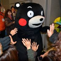 Kumamon, the popular black bear mascot of Kumamoto Prefecture, attends an event in Tokyo in February 2014. | AFP-JIJI