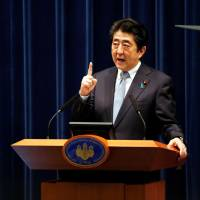 Prime Minister Shinzo Abe speaks at a news conference in Tokyo on July 20. | REUTERS