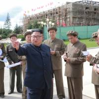 North Korean Leader Kim Jong Un visits construction sites in Samjiyon County in this undated photo released Aug. 18. The North announced Sunday that it had expelled a Japanese man recently detained during a tour of the country. | KCNA / VIA REUTERS