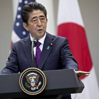 Prime Minister Shinzo Abe speaks during a news conference with U.S. President Donald Trump at the Rose Garden of the White House on June 7.   BLOOMBERG