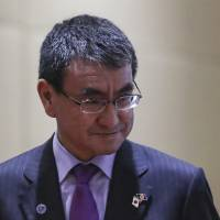 Foreign Minister Taro Kono arrives for the ASEAN-Japan Ministerial Meeting on the sidelines of the 51st ASEAN Foreign Ministers' Meeting in Singapore on Thursday, where he briefly met with North Korean counterpart Ri Yong Ho. | AP