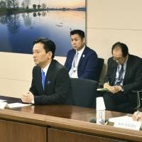 Saga Gov. Yoshinori Yamaguchi (center) speaks while holding a meeting with Defense Minister Itsunori Onodera at the Saga Prefectural Government office on Friday. | KYODO