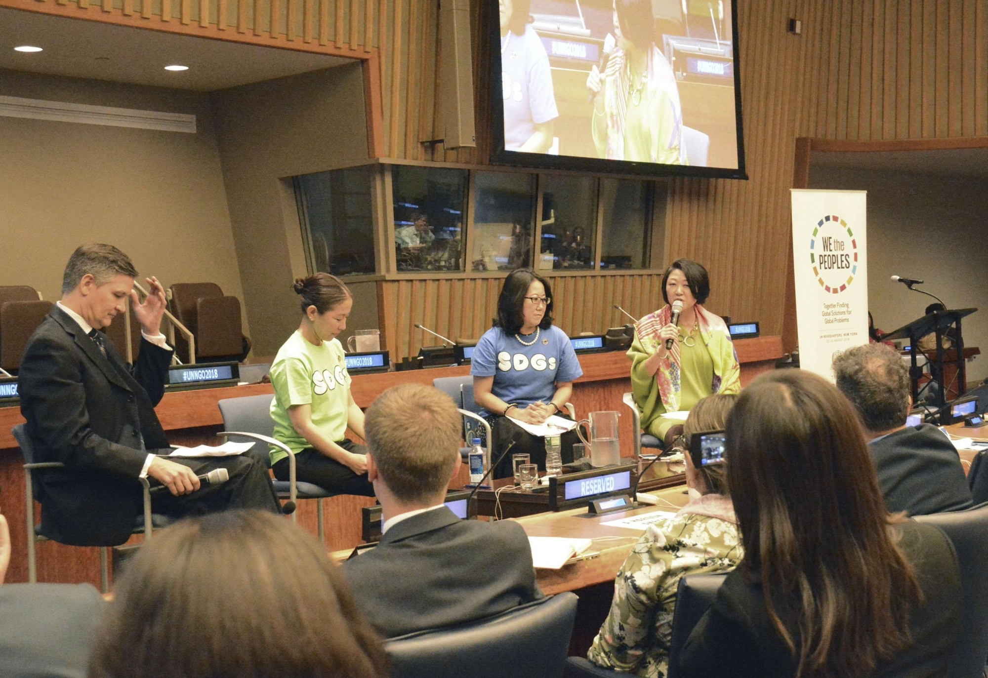 Kaoru Nemoto (back right), the Tokyo director of the U.N. Information Center, speaks at a U.N. civil society conference on Sustainable Development Goals along with Miyabi Haneda (back, second from left) of Yoshimoto Kogyo Co. on Thursday in New York. | KYODO