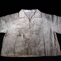 A shirt donated by Toyoko Matsumiya in 2012 to the Hiroshima Peace Memorial Museum still shows stains from so-called black rain, containing radioactive fallout, that fell on Aug. 6, 1945, after an atomic bomb destroyed the city. | CHUGOKU SHIMBUN