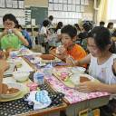 Children at an elementary school in Tokyo's Katsushika Ward eat lunch in June.