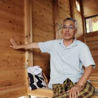 Wooden housing that sheltered Fukushima displaced now relocated for use in rain-hit western Japan